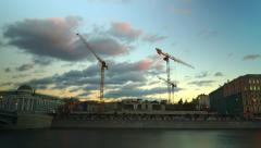 Evening Moscow river and busy construction site time lapse video Stock Footage