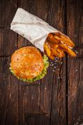 Delicious hamburger on wood Stock Photos