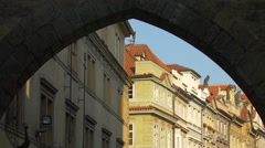 Buildings seen under the Lesser Town Bridge Tower's arch in Prague Stock Footage