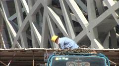 Birds Nest construction worker, Beijing Stock Footage