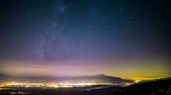 Time Lapse - Milky Way Galaxy Over the Valley Stock Footage