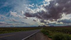 Time Lapse - Beautiful Cloudscape over Monument Valley Road Stock Footage