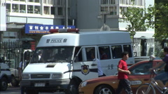 Chinese police van, loading people, China Stock Footage