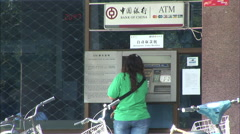 Stock Video Footage of Chinese ATM, woman withdrawing cash, China