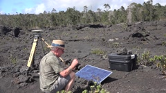 Volcanologist at work, solar electric panel Hawaii Stock Footage