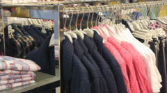 Panorama View Of Clothes On Hangers In Shop - stock footage