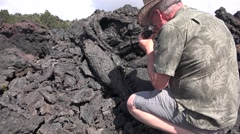 Volcanologist at work, mineral research Hawaii Stock Footage