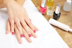 Before and after woman nails treatment in saloon Stock Photos