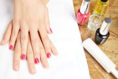 Stock Photo of Before and after woman nails treatment in saloon
