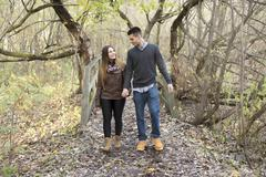 Teen couple at autumn park - stock photo