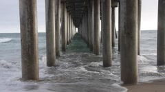 Huntington Beach Pier Underneath with Waves Stock Footage