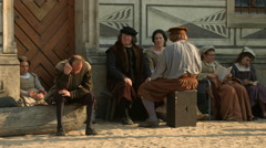 Men and women dressed in medieval clothes in Prague Stock Footage