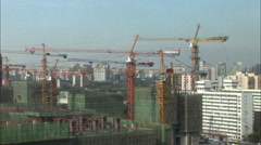 Stock Video Footage of Construction cranes & Beijing skyline, China