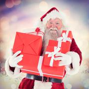 Composite image of santa carries a few presents - stock photo