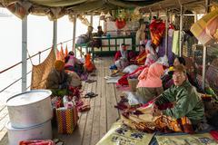 Passengers in Burmese slow boat Stock Photos