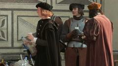 Men wearing medieval costumes in Prague Stock Footage