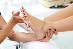 Pedicure moisturizing cram after foot rasp - stock photo