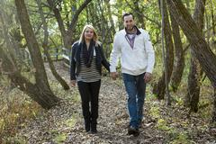 Happy middle aged couple outdoors on beautiful autumn day - stock photo