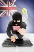 Hacker with ID card in hand and flag on background - Saint Helena - stock photo