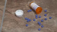 Pill Bottle and Pills on Floor Stock Footage