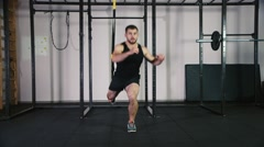 Athletic man doing exercise for the workout legs Stock Footage