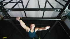 Athletic man pulled on the bar top view Stock Footage