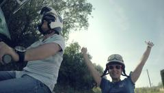 Couple of woman and man riding happily a vintage sidecar Vespa. - stock footage