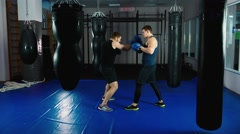 Boxer training with a partner Stock Footage