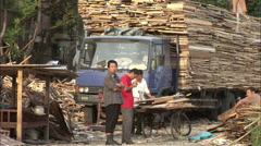 Chinese construction workers loading truck Stock Footage