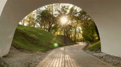 In the arch of the bridge. Autumn daytime. Smooth dolly shot. Stock Footage