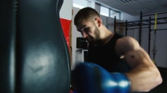 Boxing Workout: bearded man boxing Stock Footage