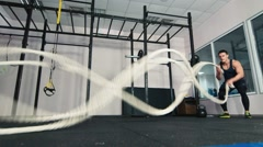 Man doing battling rope exercise at the gym Stock Footage