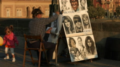 Drawing caricatures in Prague - stock footage