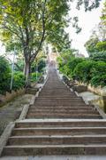 Stairway ascending uphill. Stock Photos