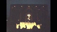 Vintage 16mm film, 1979, NYC silhouette fountain night Stock Footage