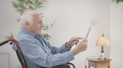 4K Caring home support nurse helping elderly man to use a computer Arkistovideo