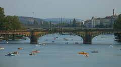 Small pedal boats on Vltava River, Prague Stock Footage