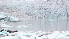 lost in epic dramatic artic glacier and iceberg sea - stock footage
