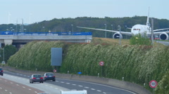 Airplane over autobahn Stock Footage