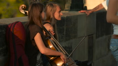 Playing the cello on Charles Bridge in Prague Stock Footage