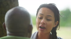 4K Relationship problems - woman arguing with her boyfriend in the park - stock footage