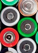 Many colorful batteries - stock photo