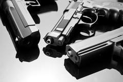 Three handguns - stock photo