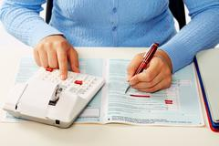 Hands of accountant woman. - stock photo