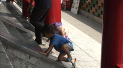 Children climbing steps, Beijing park, China Stock Footage