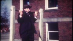 2692 - man smoking cigarette does pullups - vintage film home movie Stock Footage