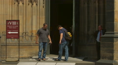 Tourists exiting St Vitus Cathedral in Prague Stock Footage