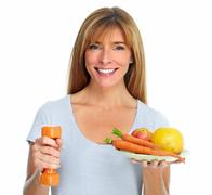 Healthy woman with dumbbell and fruits. - stock photo
