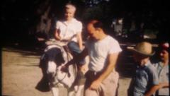 2695 - children ride a burro down on the farm - vintage film home movie Stock Footage