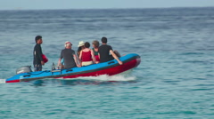 Tourists in an inflatable boat - stock footage